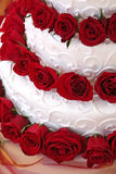 Wedding Cake. White Wedding Cake with Red Roses