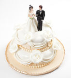 Wedding cake. With two people on top of it royalty free stock photo