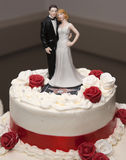 Wedding cake. With red and white rose with ornament Stock Photography