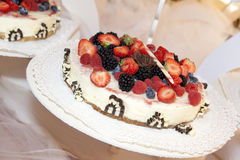 Wedding cake. A wedding cake with strawberries, raspberries, blackberries and blueberries Stock Photography