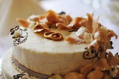 Wedding cake. With flowers of cream on it Stock Photo