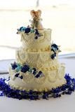 Wedding Cake. A close up on a layered wedding cake with a bride and groom on top royalty free stock images