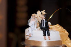 The wedding cake. On a brown background Stock Photo