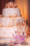 Wedding cake. Three tiered wedding cake and champagne glasses on a table stock photos