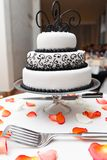Wedding cake. Cutting wedding cake with figures of flowers Royalty Free Stock Images