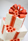 Wedding cake. With pink flowers and ribbons Stock Photo