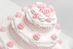 Wedding cake. Pink and white delicious luxurious wedding cake with roses Royalty Free Stock Photography