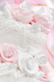 Wedding cake. Pink and white delicious luxurious wedding cake with roses Stock Photo