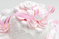 Wedding cake. Pink and white delicious luxurious wedding cake with roses Royalty Free Stock Images