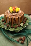 Wedding Cake. A Chocolate and Caramel wedding cake with roses on top Royalty Free Stock Image