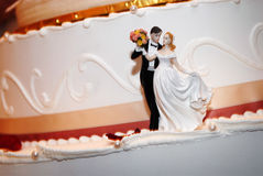 Wedding cake. With bride and groom figurine beside it Royalty Free Stock Photography