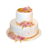Wedding cake. With white icing decorated with marzipan roses Stock Photography