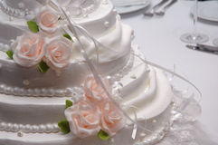 Wedding cake. On a white table Royalty Free Stock Images