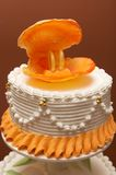 Wedding cake. With sugar shell, rings and lily Royalty Free Stock Image