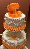 Wedding cake. With sugar shell, rings and lily Royalty Free Stock Photography