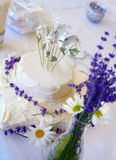 Wedding Cake. Homemade Wedding Cake with Fresh Daisies and Lavender Stock Photography