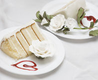 Wedding cake. Two pieces of a wedding cake on different plates Royalty Free Stock Photo