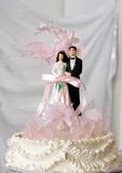 Wedding cake. Top tier of the wedding cake with bride and groom Stock Images