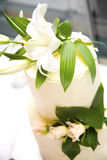 Wedding cake. Special wedding cake with white lilly flowers stock photo