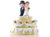 Wedding cake. With bride and groom on a white background Royalty Free Stock Image