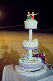 Wedding cake on the beach. Wedding in the tropics concept Stock Image