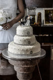 Wedding Cake. Beautiful Wedding Cake with bride in the background Royalty Free Stock Photos