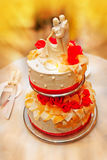 Big wedding cake with figurines dancing newlyweds Stock Image