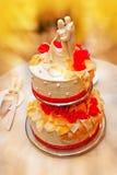 Big wedding cake with figurines dancing newlyweds Stock Image