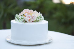 Wedding cake beautiful decorated with roses Stock Photography