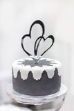 Wedding cake in black and white with heart decoration. Royalty Free Stock Photography