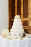 Wedding cake and bouquet. Wedding cake and brides bouquet of flowers at reception Stock Images