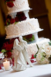 Wedding cake with bride and groom Stock Photography
