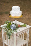 Wedding cake and brides bouquet Royalty Free Stock Image