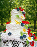 Wedding cake. With bright flowers Royalty Free Stock Photography