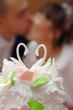 Wedding cake with broom and bride Royalty Free Stock Image