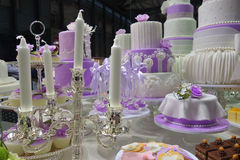Wedding cake and candles Stock Images