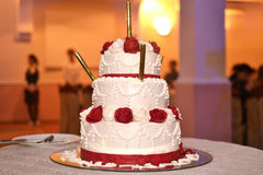 Wedding cake with candles. Wedding cake decorated with beautiful red flowers Stock Photography