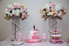 Wedding cake. Candy bar marshmallow on the table in a vase, macaroon, and cupcake, decor vanilla, handmade sweets Stock Photo
