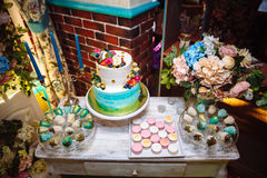 Wedding cake. Candy bar marshmallow on the table in a vase, macaroon, and cupcake, decor vanilla, handmade sweets. Top. Wedding cake. Candy bar marshmallow on Stock Photos