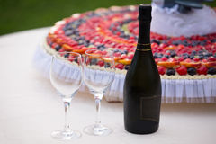 Wedding Cake and Champagne Bottle Stock Image