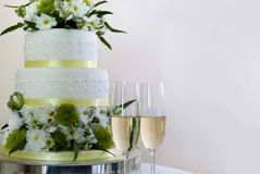 Wedding cake and champaign. Wedding cake with 2 glasses of champaign Royalty Free Stock Photos