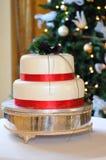 Wedding cake at Christmas wedding. Wedding cake at Christmas wedding with red bands Stock Photos