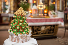 Wedding cake in the church, ceremony of stylish elegant  bride a Stock Images