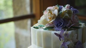 Wedding cake. A close up dolly shot of a beautifully decorated wedding cake stock footage
