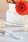 Wedding cake closeup with orange daisy Stock Image