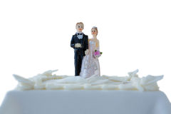 Wedding cake with couple figurines Stock Images