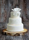 Wedding cake covered with white fondant Royalty Free Stock Images