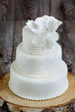 Wedding cake covered with white fondant Stock Photos