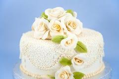 Wedding cake cream coloured. Cream coloured wedding cake with floral decoration Stock Photography