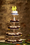 Wedding cake with cupcakes Royalty Free Stock Photo